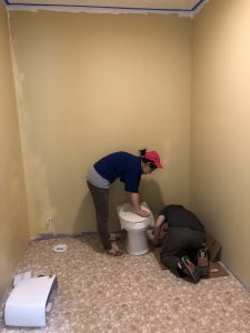 Bi lin and brother Jin are installing toilet.
