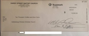 check of $10,000